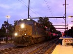 CSX 3151 leads L036 at dusk.